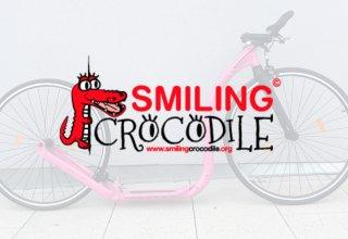 Vánoční dražba růžové Race MAX 28 pro děti ze Smiling Crocodile